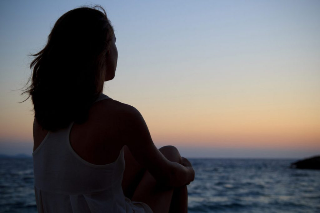 Lonely Young Woman, Watching The Sea Sunset